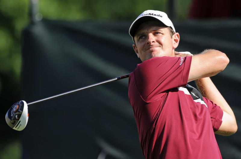 Justin Rose, of England, watches his drive on the 18th hole during the first round of the Travelers Championship golf tournament in Cromwell, Conn., Thursday, June 20, 2013. Rose, winner of the 2013 U.S. Open, finished the round with a 67. (AP Photo/Fred Beckham)