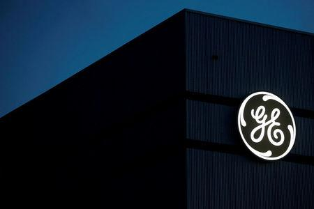 FILE PHOTO: The General Electric logo is pictured on the General Electric offshore wind turbine plant in Montoir-de-Bretagne
