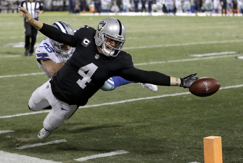 Derek Carr's fumble at the end zone against the Cowboys summed up a disappointing season for the Raiders. (AP)