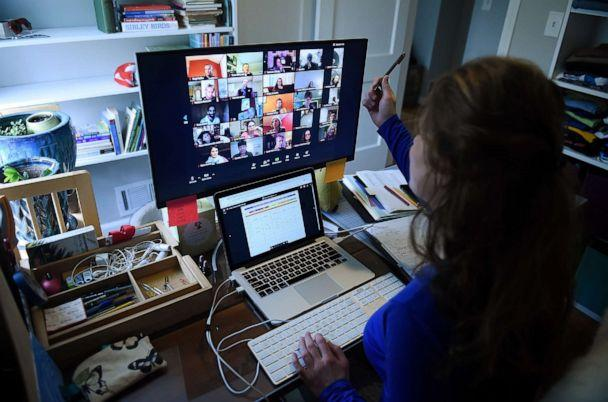 PHOTO: Lauryn Morley, a substitute teacher for the Washington Waldorf School in Bethesda, Maryland, works from her home due to the Coronavirus outbreak, on April 1, 2020 in Arlington, Virginia. (Olivier Douliery/AFP via Getty Images)