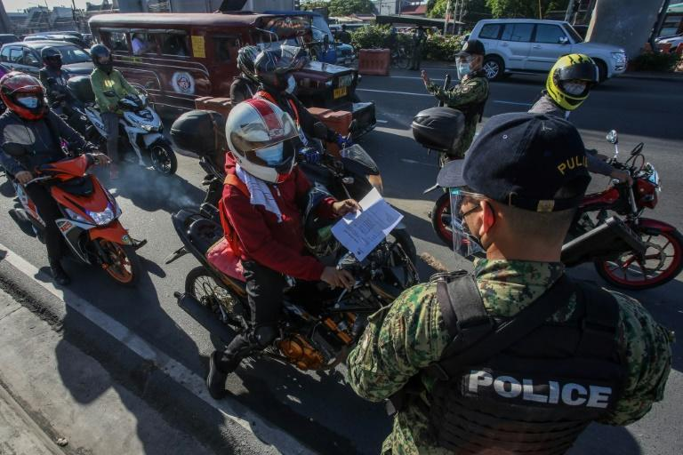 Traffic was backed up for hundreds of metres at checkpoints in the capital Manila as police tried to ensure only essential workers were travelling