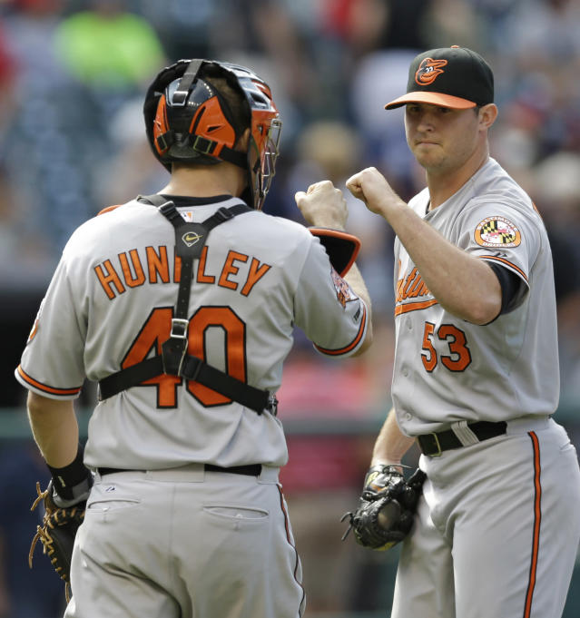 Baltimore Orioles relief pitcher Zach Britton, right, and catcher Nick Hundley celebrate after they defeated the Indians 4-1 in a baseball game, Sunday, Aug. 17, 2014, in Cleveland. (AP Photo/Tony Dejak)