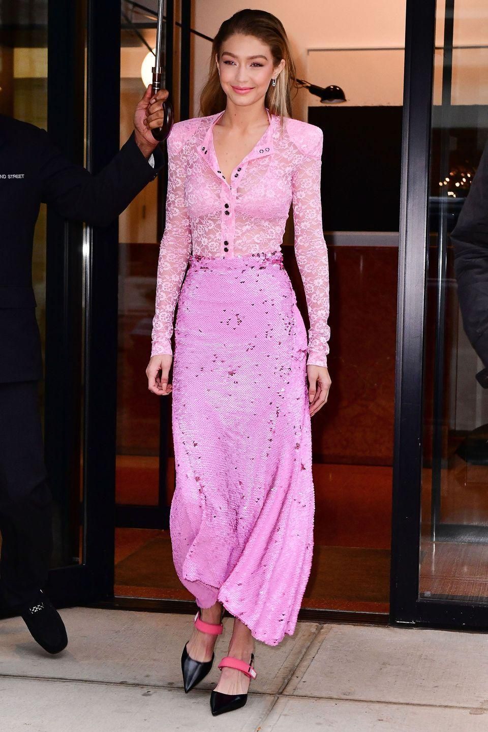 <p>In a Nina Ricci sheer pink lace bodysuit and floral maxi skirt, Prada slingback heels, and Messika white gold earrings while out in New York.</p>