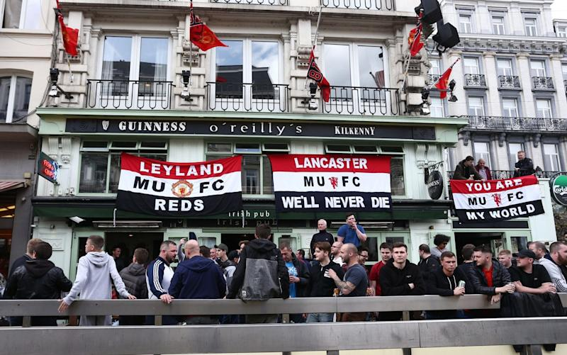 United fans outside an Irish pub in Brussels, the world capital of beer - Credit: BPI/REX/Shutterstock