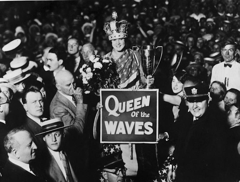 American swimmer Gertrude Ederle, the first female to swim across the English Channel, is honoured for her historic swim and crowned 'Queen of the Waves', September 8, 1926 in New York City. (Photo by Topical Press Agency/Getty Images)