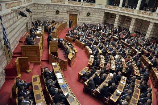 Greek Prime Minister Antonis Samaras gives his closing speech at the Greek parliament in Athens. The Greek parliament on Sunday approved a slashed 2013 budget which the government has vowed will secure the release of foreign aid vital to save the debt-ridden country from insolvency