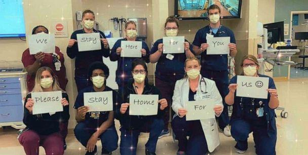 PHOTO: Healthcare workers at BJC HealthCare in Missouri hold signs urging people to stay home during the coronavirus pandemic. (BJC HealthCare)