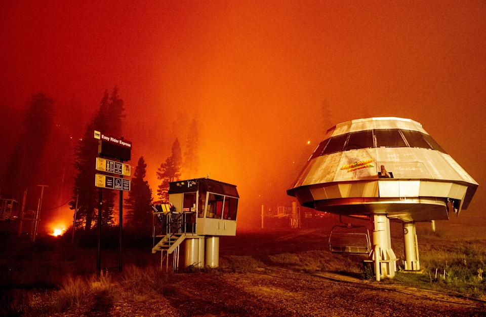 Flames surround a chair lift at Sierra-at-Tahoe Resort