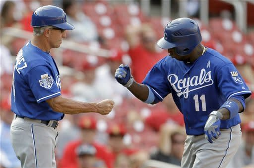 Kansas City Royals' Yuniesky Betancourt, right, is congratulated by third base coach Eddie Rodriguez after hitting a two-run home run during the 15th inning of a baseball game against the St. Louis Cardinals, Sunday, June 17, 2012, in St. Louis. The Royals won 5-3. (AP Photo/Jeff Roberson)