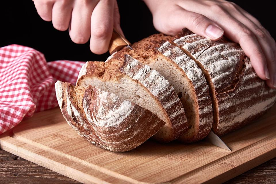 """<p>What do you call the end piece of <a href=""""https://www.thedailymeal.com/travel/bread-around-the-world-from-baguettes-to-naan-gallery?referrer=yahoo&category=beauty_food&include_utm=1&utm_medium=referral&utm_source=yahoo&utm_campaign=feed"""" rel=""""nofollow noopener"""" target=""""_blank"""" data-ylk=""""slk:a loaf of bread"""" class=""""link rapid-noclick-resp"""">a loaf of bread</a>? You know, the one with a full side of crust? These two slices are the cause of much discussion, as they go by many names. According to a Twitter debate, this piece of bread is alternately referred to as the butt, knob, heel, outside, crust, ender and other weird names. But, according to the Atlantic, heel is the most commonly used term.</p>"""
