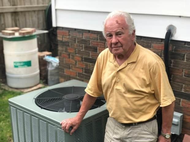 Gunther Wolf, a Reliance Home Comfort customer, is frustrated over the lack of service and lack of information regarding the current province-wide lockout.  (Jacob Barker/CBC - image credit)