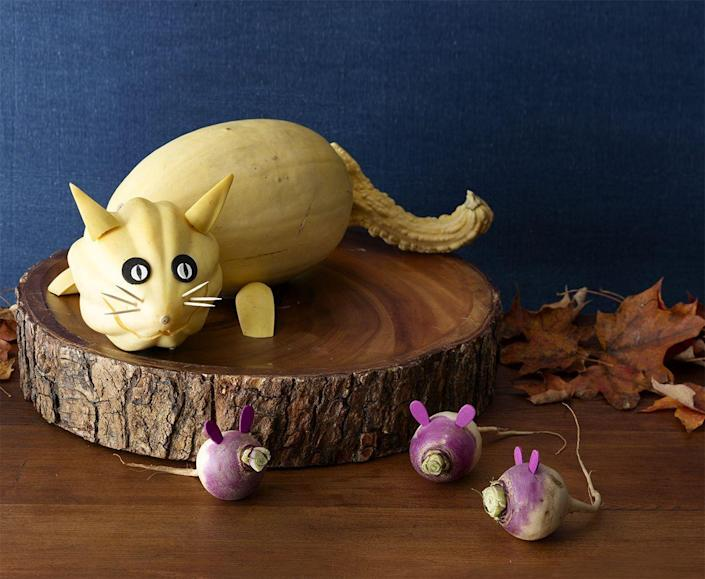 """<p>Gourds and radishes become an adorable display with a few other accessories. </p><p><strong><em><a href=""""https://www.womansday.com/home/crafts-projects/a28712324/sneaky-kitty-and-mice-pumpkin/"""" rel=""""nofollow noopener"""" target=""""_blank"""" data-ylk=""""slk:Get the Sneaky Kitty and Mice Pumpkin tutorial"""" class=""""link rapid-noclick-resp"""">Get the Sneaky Kitty and Mice Pumpkin tutorial</a>. </em></strong></p><p><a class=""""link rapid-noclick-resp"""" href=""""https://www.amazon.com/Makerstep-Toothpicks-Cocktail-Appetizer-Barbecue/dp/B07WC2X2B4?tag=syn-yahoo-20&ascsubtag=%5Bartid%7C10070.g.2488%5Bsrc%7Cyahoo-us"""" rel=""""nofollow noopener"""" target=""""_blank"""" data-ylk=""""slk:SHOP TOOTHPICKS"""">SHOP TOOTHPICKS</a></p>"""