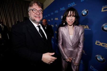 """Director del Toro is congratulated by actor Sally Hawkins after accepting the award for Outstanding Directorial Achievement in Feature Film for """"The Shape of Water"""" at the 70th Annual DGA Awards in Beverly Hills"""