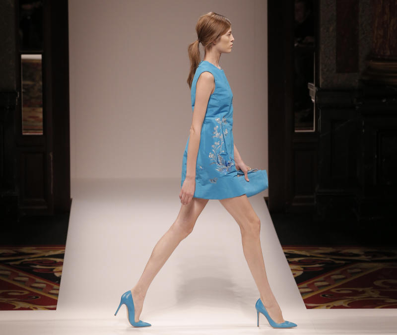 A model wears a creation for fashion designer Shiatzy Chen's ready to wear Spring-Summer 2013 collection, in Paris, Tuesday, Oct. 2, 2012. (AP Photo/Francois Mori)