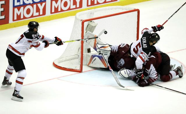 Ice Hockey - 2018 IIHF World Championships - Group B - Canada v Latvia - Jyske Bank Boxen - Herning, Denmark - May 14, 2018 - Connor McDavid of Canada scores the winning goal. REUTERS/David W Cerny