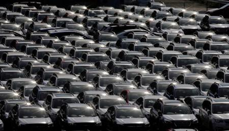 Newly manufactured cars of the automobile maker Subaru await export in a port in Yokohama