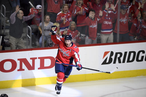 FILE - In this April 13, 2019, file photo, Washington Capitals defenseman Brooks Orpik (44) celebrates his game-winning goal in overtime of Game 2 of an NHL hockey first-round playoff series against the Carolina Hurricanes in Washington. Orpik has decided to retire after 15 seasons and two Stanley Cup championships. The 38-year-old announced his retirement Tuesday, June 25, 2019. Orpik says his body is telling me it is time to move on to something new after 1,171 NHL regular-season and playoff games. (AP Photo/Nick Wass, File)