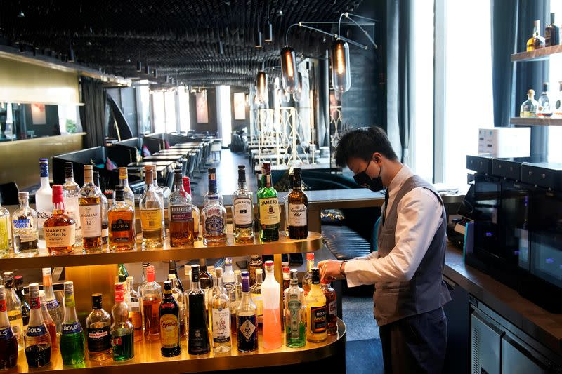 A bartender wearing a mask is seen at seul&SEUL restaurant in downtown Shanghai
