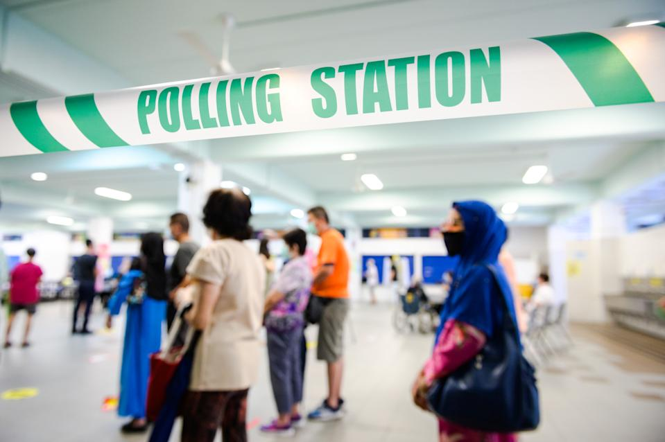 People queueing to vote at the Dunearn Secondary School polling centre on 10 July. (PHOTO: Joseph Nair for Yahoo News Singapore)
