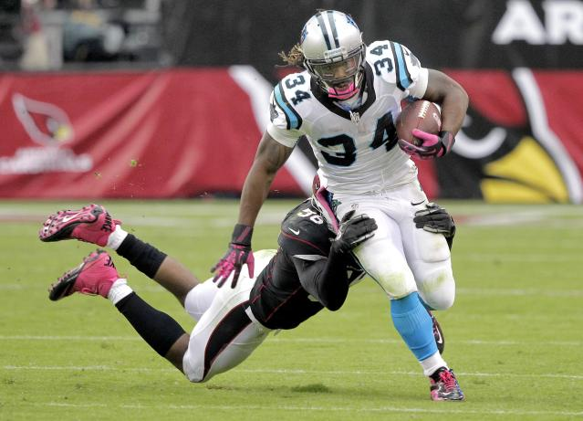 Carolina Panthers running back DeAngelo Williams (34) is tackled by Arizona Cardinals inside linebacker Karlos Dansby (56) during the second half of a NFL football game, Sunday, Oct. 6, 2013, in Glendale, Ariz. (AP Photo/Rick Scuteri)