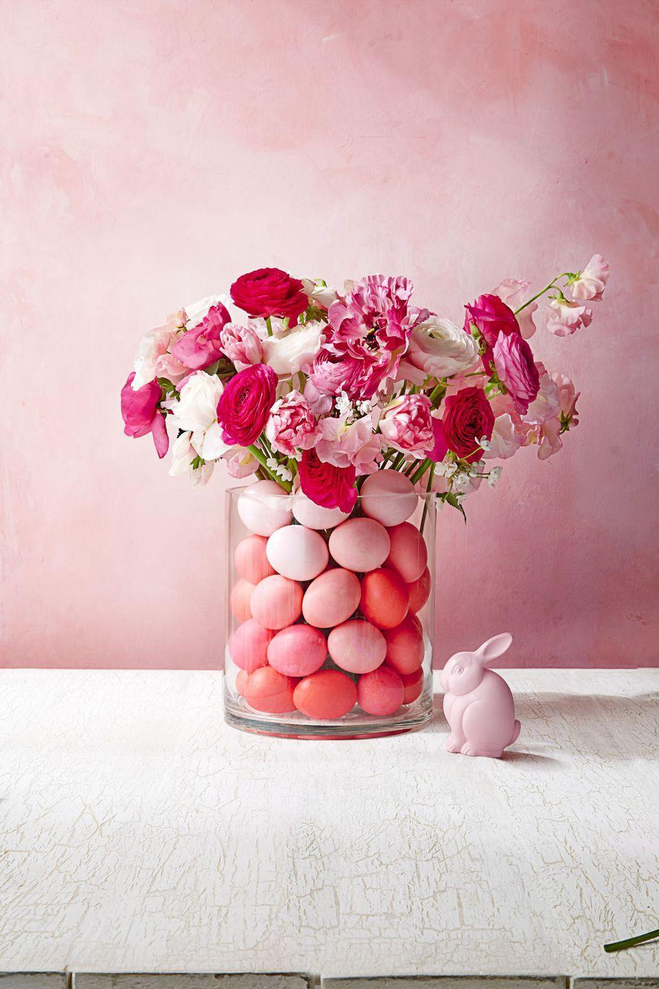 """<p>The combination of ombré eggs and complementary florals make this the perfect centerpiece for your table.<br></p><p><em><u><a href=""""https://www.goodhousekeeping.com/holidays/easter-ideas/how-to/g3334/easter-egg-bouquet/"""" rel=""""nofollow noopener"""" target=""""_blank"""" data-ylk=""""slk:Get the tutorial »"""" class=""""link rapid-noclick-resp"""">Get the tutorial »</a></u></em></p>"""