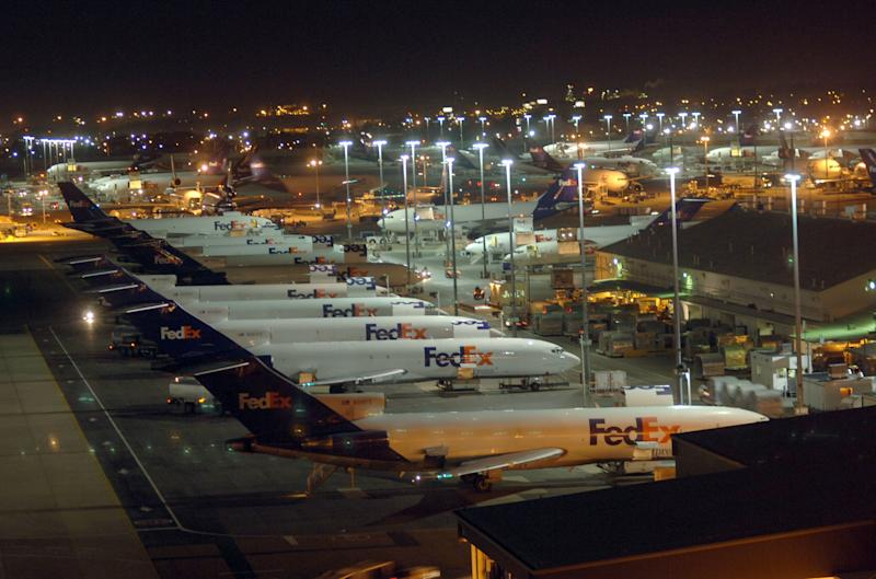 FILE - In this Dec. 14, 2006 file photo, FedEx planes wait to be loaded and unloaded at their hub in the Memphis International Airport.  The Memphis economy relies on FedEx for 30,000 jobs and the billions of dollars of business FedEx creates at Memphis International Airport. FedEx shipped 98 percent of cargo put aboard an airplane in 2007 at the airport, which had a $28.6 billion impact on the area that year, according to a 2009 study commissioned by the airport. (AP Photo/Greg Campbell, File)