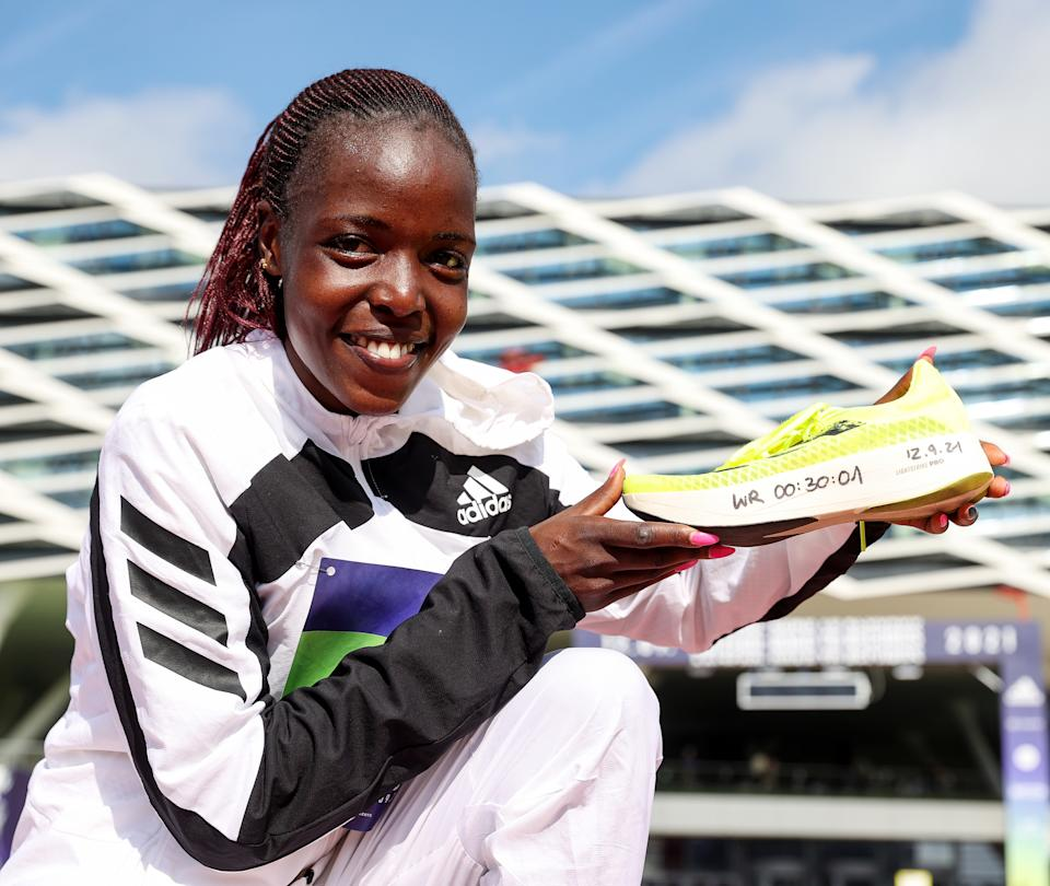 Seen here, Kenya's Agnes Tirop posing for a photo after her 10km world record.