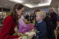 Grinning at a young boy after he presented her with flowers at Joe's Ice Cream Parlour on Mumbles Road, near Swansea in February 2020. Kate screwed up her nose showing her playful side. (Arthur Edwards/The Sun/PA Wire)