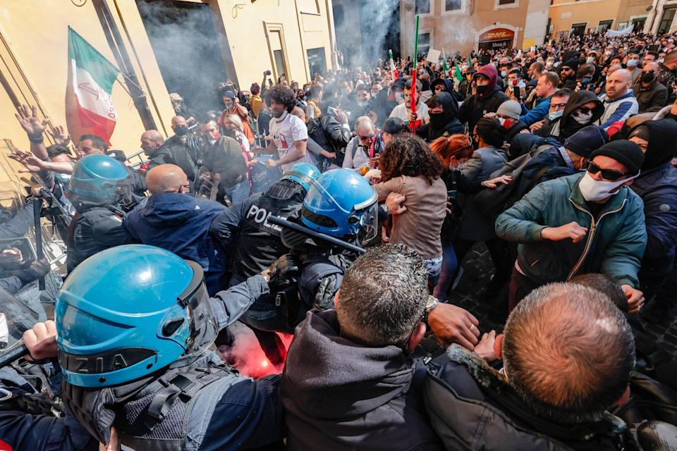 Traders, shopkeepers and restaurateurs clash with police during a protest next to the Chamber of Deputies in Piazza Montecitorio, Rome, Italy, earlier this week (EPA)
