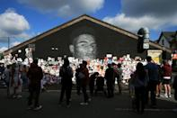 A mural of England forward Marcus Rashford in Manchester was defaced by racist abuse but soon wellwishers had covered the graffiti with messages of support