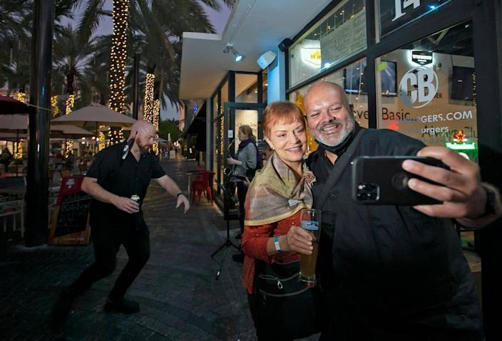 South Florida Professionals members Jan Hurley and Andy Rodriguez take a selfie at Clutch Burger on Giralda Plaza during the group's first networking event since the outbreak of COVID-19.