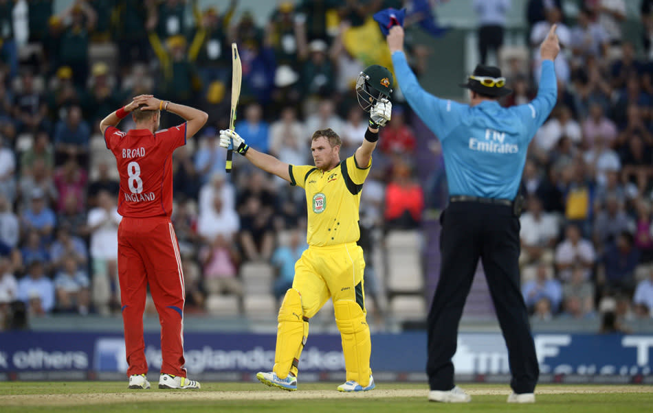 Australia's Aaron Finch celebrates after reaching his century from a six during the first T20 international against England at the Rose Bowl cricket ground, Southampton August 29, 2013. REUTERS/Philip Brown