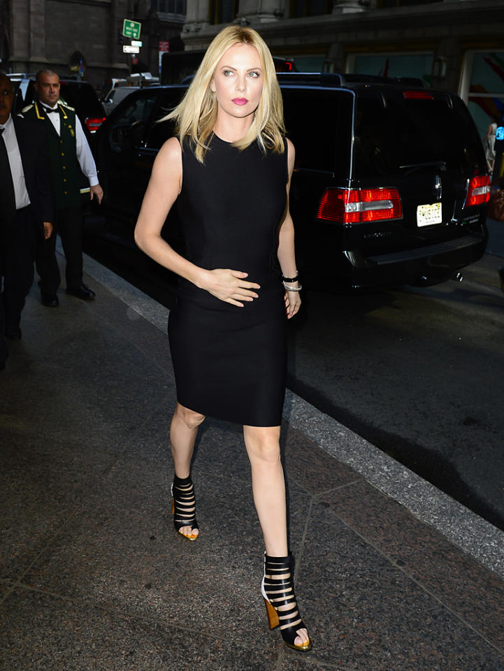 "Earlier that day, Stewart's on-screen nemesis, Charlize Theron (aka The Evil Queen), looked stunning in an all-black getup as she headed to a taping of ""Today"" at Rockefeller Center. While we like her sophisticated Lanvin sheath, we <i>love</i> her sexy Christian Louboutin ankle boots, which retail for a whopping $1,300! (5/29/2012)"
