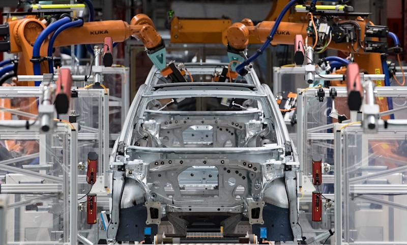 25 February 2020, Saxony, Zwickau: In the body shop of the Volkswagen plant in Saxony, robots assemble the doors of the VW ID.3. At the beginning of November 2019, Volkswagen initiated the system change to electromobility with the production start of the ID.3. The vehicle is the first model of the fully electric ID. family and is to establish the mass business with electric vehicles at the world's largest manufacturer. This year, VW plans to produce around 100,000 electric cars in Zwickau using the modular electric kit. From summer onwards, the vehicle is to be available for purchase throughout Europe. Around 8,000 people are currently employed at the Zwickau site. Photo: Hendrik Schmidt/dpa-Zentralbild/ZB (Photo by Hendrik Schmidt/picture alliance via Getty Images)