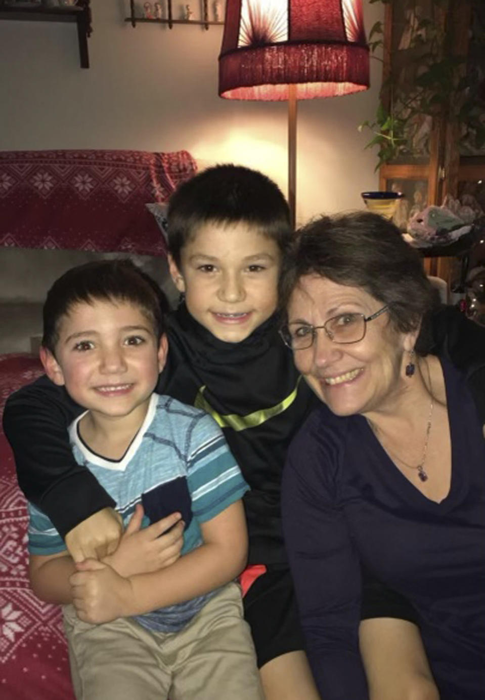 In this December 2019 photo, provided by Barbara Trout, she poses with grandsons Grayson, center, and Garrett, left, in Keizer, Ore. Trout, who suffers from asthma, was taken to ambulance to a hospital twice in September following exposure to smoke from wildfires that reached hazardous levels. (Barbara Trout via AP)