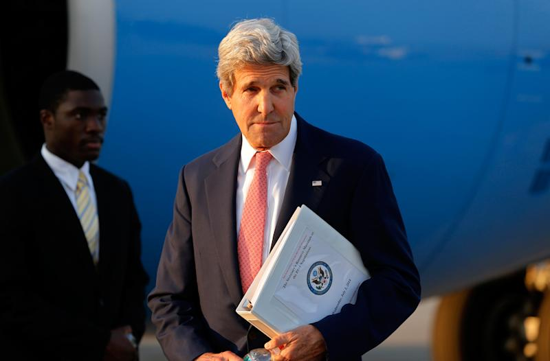 US Secretary of State John Kerry looks on after arriving at Vienna International Airport on July 13, 2014