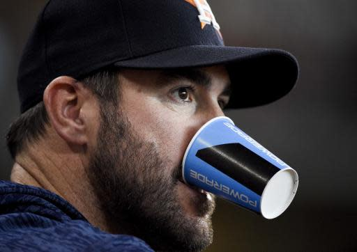 Houston Astros' Justin Verlander watches from the dugout during the eighth inning of a baseball game against the Cleveland Indians, Saturday, May 19, 2018, in Houston. (AP Photo/Eric Christian Smith)