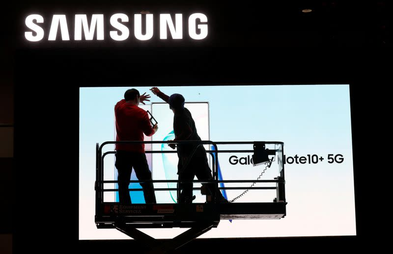FILE PHOTO: Workers set up a Samsung display in the lobby of the Las Vegas Convention Center in preparation for the 2020 CES in Las Vegas