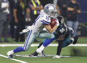 Dallas Cowboys wide receiver Cole Beasley (11) avoids a tackle by Jacksonville Jaguars defensive end Lerentee McCray (55) in the second half of an NFL football game in Arlington, Texas, Sunday, Oct. 14, 2018. (AP Photo/Jim Cowsert)