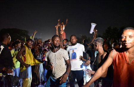 Supporters of Felix Tshisekedi, leader of the Congolese main opposition party, the Union for Democracy and Social Progress (UDPS) celebrate along the streets after the judges of the Constitutional Court confirmed Tshisekedi's victory in the presidential election in Kinshasa, Democratic Republic of Congo January 20, 2019. REUTERS/Olivia Acland
