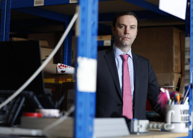 Steve Folwell, the CEO of Lovespace poses for a portrait at the Lovespace warehouse in Dunstable, England Monday, Jan. 14, 2019. Lovespace, which collects boxes from customers, stores them and then returns the goods when needed, says revenue from businesses doubled over the past year as enterprises large and small began stockpiling inventory because of concerns they will be cut off from suppliers if Britain leaves the European Union without an agreement on future trading relations. (AP Photo/Alastair Grant)