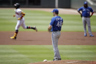 Toronto Blue Jays pitcher Ross Stripling (48) waits for Atlanta Braves' Ronald Acuna Jr., left, to run the bases after giving up a home run in the first inning of a baseball game Thursday, May 13, 2021, in Atlanta. (AP Photo/Ben Margot)
