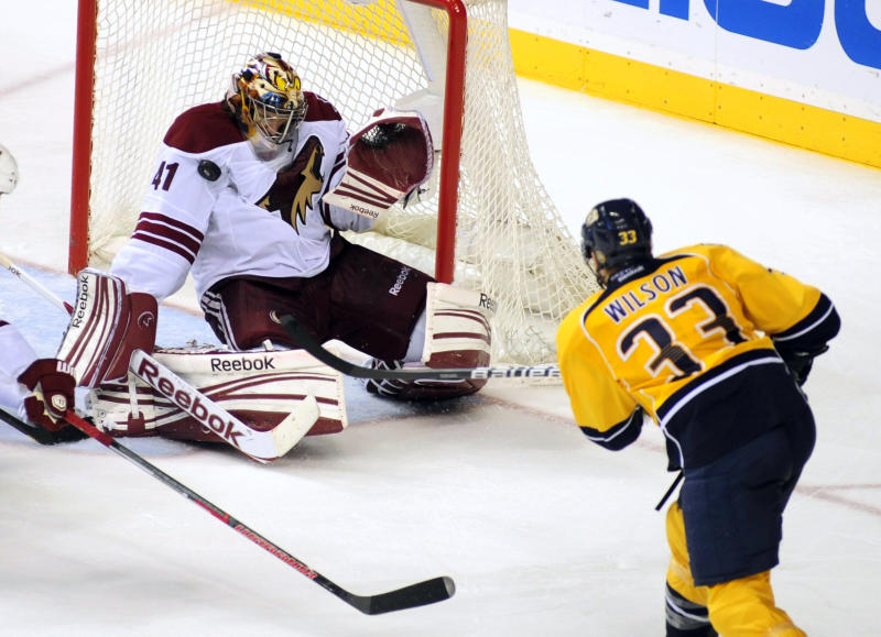 Phoenix Coyotes goalie Mike Smith (41) stops the shot of Nashville Predators left wing Colin Wilson (33) in the third period of Game 4 in an NHL hockey Stanley Cup Western Conference semifinal playoff series, Friday, May 4, 2012, in Nashville, Tenn. Phoenix won 1-0. (AP Photo/Mike Strasinger)
