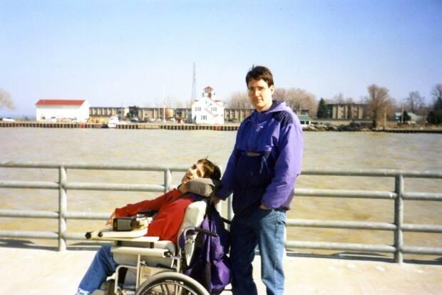 Justin Clark, left, known for his contributions to disability rights, died on Thursday. His brother is on the right.