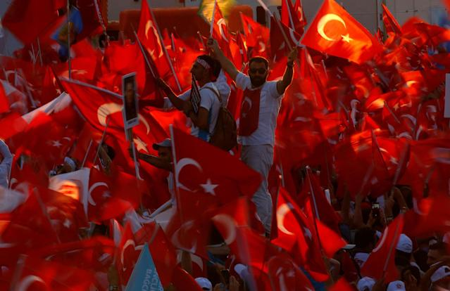 <p>People wave Turkey's national flags as they attend a ceremony marking the first anniversary of the attempted coup at the Bosphorus Bridge in Istanbul, Turkey July 15, 2017. (Photo: Murad Sezer/Reuters) </p>