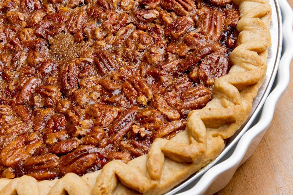 """<p>Another classic Thanksgiving dessert is pecan pie, which, according to <a href=""""https://www.eater.com/2016/11/23/13575790/pecan-pie-history-about"""" rel=""""nofollow noopener"""" target=""""_blank"""" data-ylk=""""slk:Eater"""" class=""""link rapid-noclick-resp"""">Eater</a>, is an American creation. Pecans are native to North America and the nuts were eaten by Native Americans. We don't know when, for sure, the pie became a popular recipe, but the earliest recipes began appearing in Texas cookbooks in the 1870s and 1880s. And since pecan harvesting begins in September and goes through November, it makes sense that it became a food tied to Thanksgiving. </p>"""