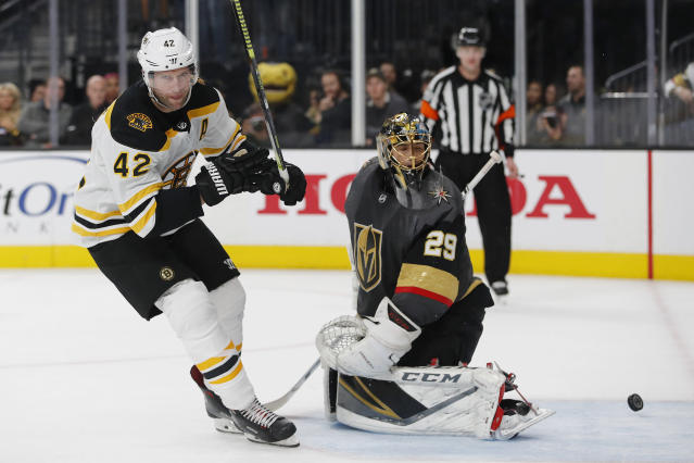 Boston Bruins right wing David Backes (42) scores on Vegas Golden Knights goaltender Marc-Andre Fleury (29) during the shootout in an NHL hockey game Wednesday, Feb. 20, 2019, in Las Vegas. Boston won 3-2. (AP Photo/John Locher)
