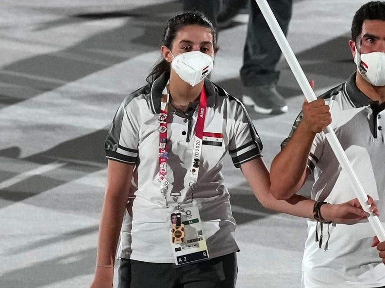 syria flag bearers entering the parade of nations at opening ceremony of tokyo 2020 olympics