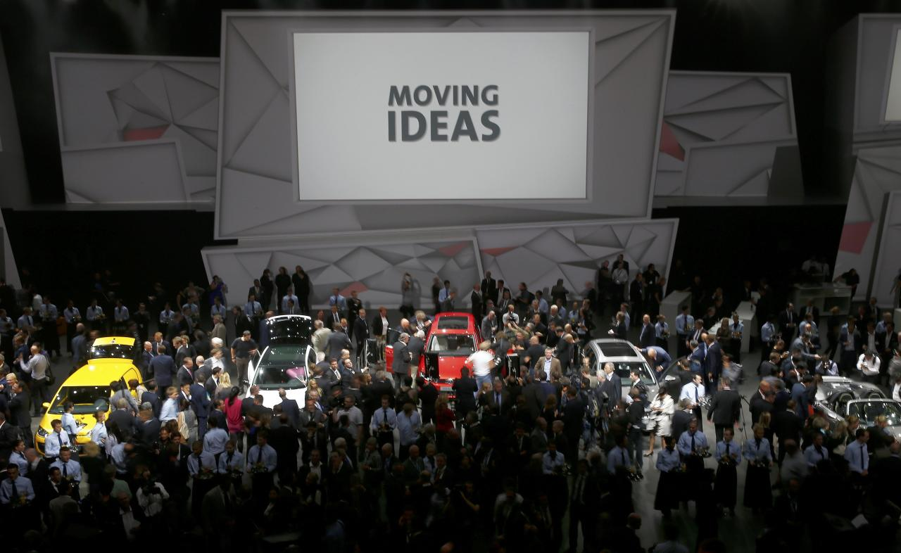 Media and guests gather after the Volkswagen group night at the Frankfurt motor show September 9, 2013. The world's biggest auto show is open to the public September 14 -22. REUTERS/Kai Pfaffenbach (GERMANY - Tags: BUSINESS TRANSPORT)