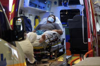 A man lays in an ambulance at the emergency service of the hospital in Papeete, Tahiti island, French Polynesia, Friday Aug.20, 2021. France's worst virus outbreak so far is unfolding 12 times zones away from Paris, devastating Tahiti and the idyllic atolls of French Polynesia. It's France's latest challenge in juggling resources to battle the pandemic in former colonies that stretch around the world (AP Photo/Esther Cuneo)